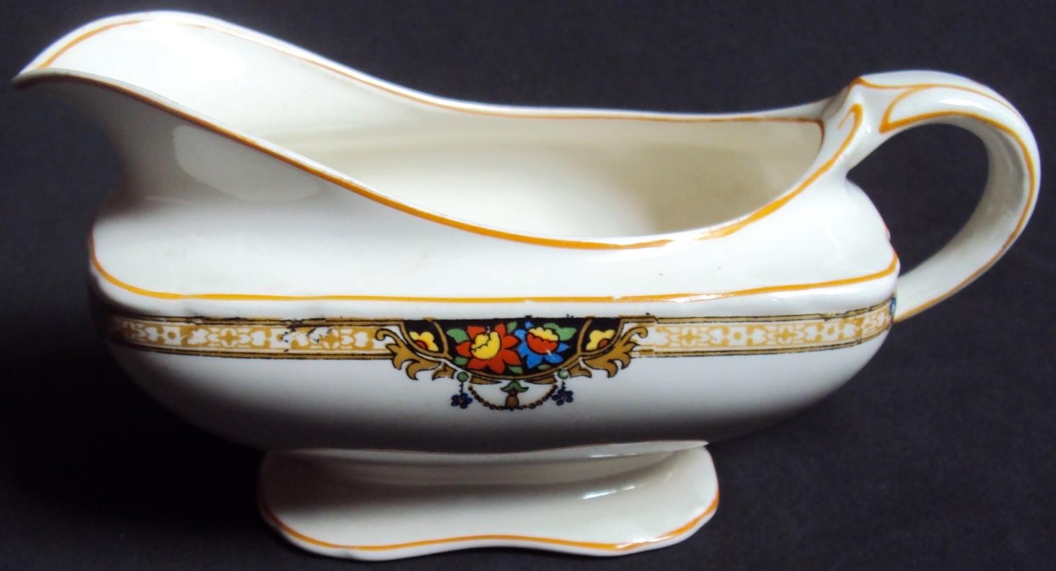 LO 252 – Molheira antiga de porcelana inglesa Grindley Windsor com flores e arabescos